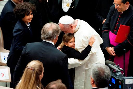 Pope Francis embraces a child during a special audience with relatives and close friends of the more than 80 victims of the attack in Nice in Paul VI hall at the Vatican September 24, 2016. REUTERS/Massimiliano Migliorato