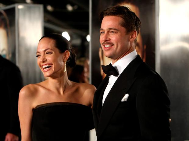 Actress Angelina Jolie and actor Brad Pitt arrive at the premiere of Paramount's
