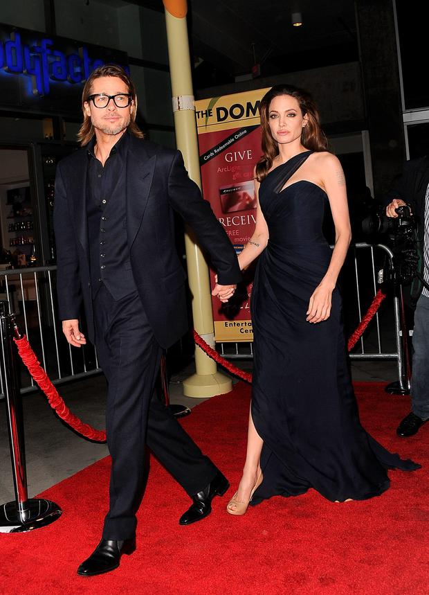 Actor Brad Pitt (L) and Writer/Director Angelina Jolie arrive at the \'In the Land of Blood and Honey' premiere held at ArcLight Cinemas on December 8, 2011 in Hollywood, California. (Photo by Jason Merritt/Getty Images)