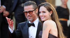 US actors Brad Pitt and Angelina Jolie pose on the red carpet before the screening of