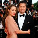 CANNES, FActors Brad Pitt and Angelina Jolie attend the Inglourious Basterds Premiere held at the Palais Des Festivals during the 62nd International Cannes Film Festival on May 20th, 2009 in Cannes, France. (Photo by Gareth Cattermole/Getty Images)