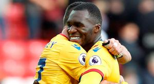 Crystal Palace's Christian Benteke and Damien Delaney celebrate at full time Action Images via Reuters / Ed Sykes