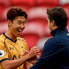 Tottenham's Son Heung-min celebrates with manager Mauricio Pochettino at full time Reuters / Russell Cheyne