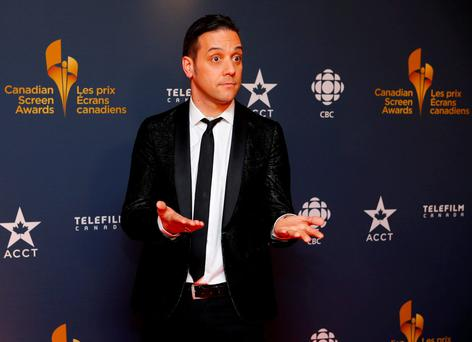 CBC personality George Stroumboulopoulos arrives on the red carpet at the 2014 Canadian Screen awards in Toronto. REUTERS/Mark Blinch/File Photo
