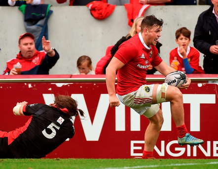 Conor Oliver gets away from Ben Toolis to score his side's third try. Photo: Diarmuid Greene/Sportsfile