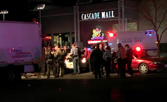 Emergency personnel attend the scene in which several people were killed at the Cascade Mall, Burlington. Photo: AP