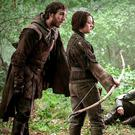 Young blood: Arya Stark, played by Maisie Williams, shoots with the Brotherhood without Banners in 'Game of Thrones'