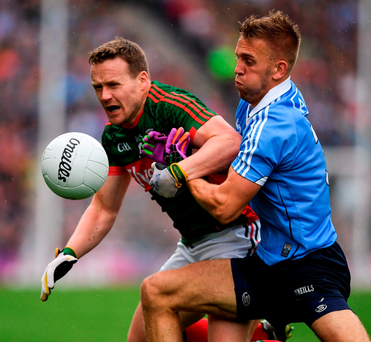 Andy Moran of Mayo in action against Jonny Cooper of Dublin. Photo: Sportsfile