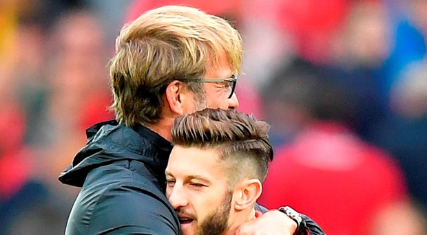 Liverpool manager Jurgen Klopp (left) embraces Adam Lallana after the final whistle. Photo: Dave Howarth/PA