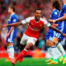 Theo Walcott of Arsenal celebrates scoring his sides second goal. Photo: Getty