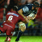 Connacht's Eoin McKeon is tackled by Aaron Shingler of Scarlets during the Guinness PRO12 Round 4 at Parc Y Scarlets, Llanelli. Photo: Chris Fairweather/Sportsfile