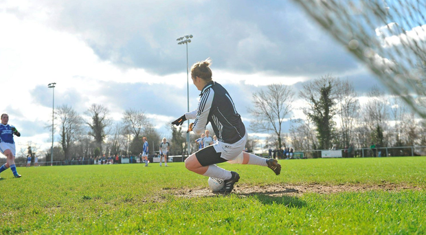 Mary Hulgraine, Kildare, saves a penalty from Noirin Kirwan, Laois. Photo: Sportsfile