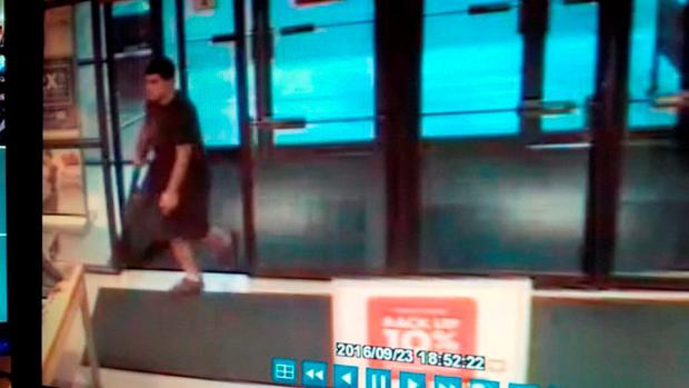 An image taken from security video shows the gunman who opened fire in the Cascade Mall in Burlington, Washington