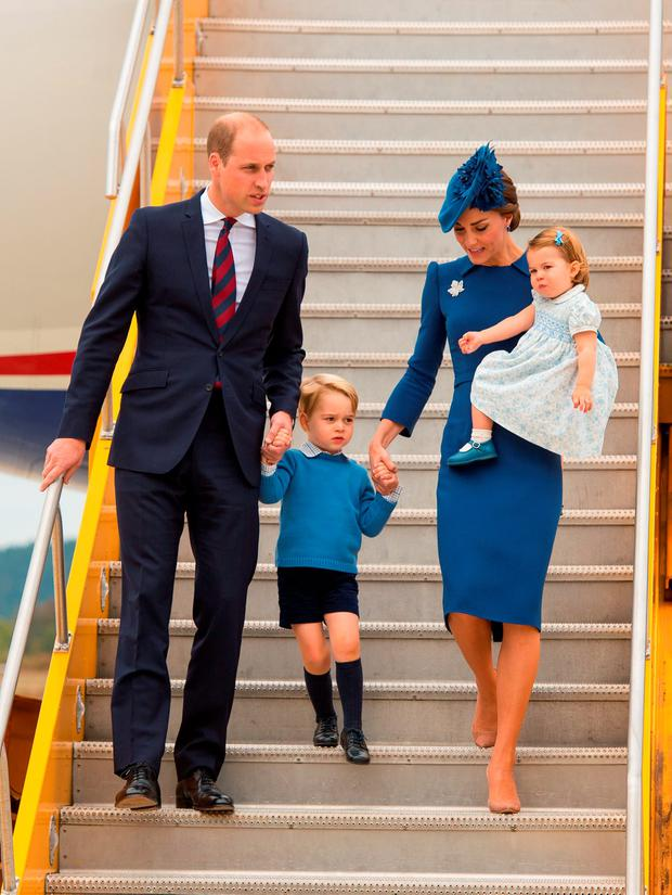Prince William, Duke of Cambridge, Catherine, Duchess of Cambridge, Prince George of Cambridge and Princess Charlotte of Cambridge arrive at 443 Maritime Helicopter Squadron near Victoria international airport
