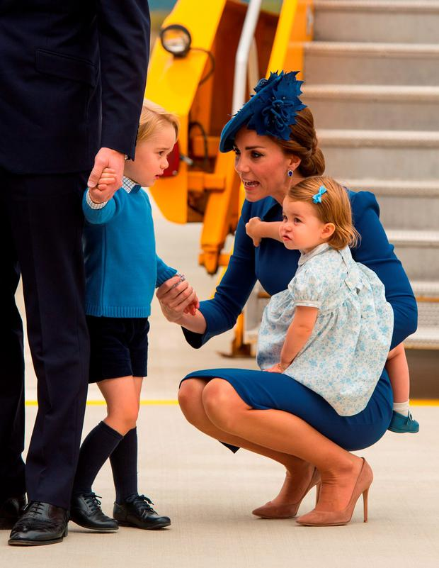 Catherine, Duchess of Cambridge, Prince George of Cambridge and Princess Charlotte of Cambridge arrive at 443 Maritime Helicopter Squadron near Victoria international airport on September 24, 2016 in Victoria, Canada. (Photo by Dominic Lipinski-Pool/Getty Images)