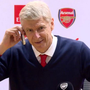 Arsene Wenger pretends to answer a phone call during his press conference Twitter/@Arsenal