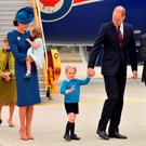 The Prime Minister of Canada Justin Trudeau (left) watches after greeting the Duke and Duchess of Cambridge and their children Prince George and Princess Charlotte, at Victoria International Airport, in Victoria, Canada, on the first day of their official tour of Canada.