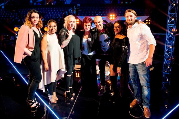 Sharon Osbourne with her final 6 of the Over 25s (left to right) Janet Grogan, Ivy Grace Paredes, Samantha Atkinson, Christopher Peyton, Relley C and James Wilson during the six chair challenge for the ITV1 talent show, The X Factor. Picture: Syco/Thames/Dymond/PA Wire