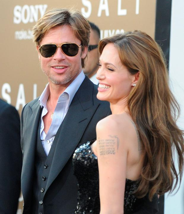 Actor Brad Pitt (L) and actress Angelina Jolie arrive at the premiere of Sony Pictures' 'Salt' at Grauman's Chinese Theatre on July 19, 2010 in Hollywood, California. (Photo by Jason Merritt/Getty Images)