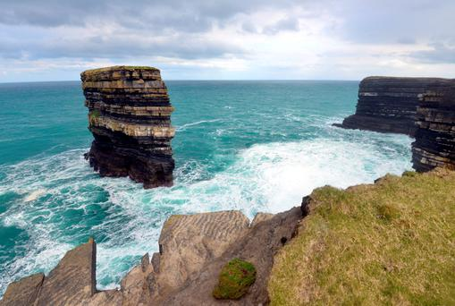 The sea stack at Downpatrick Head, one of the many spectacular places to visit on the Wild Atlantic Way