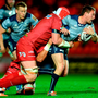 Kieran Marmion of Connacht is tackled by Jake Ball of Scarlets. Photo by Chris Fairweather/Sportsfile