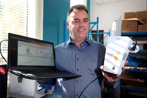 Stephen Daniels from Nuwave Sensor Technology with a Nuwave pathogen sensor and computer display. Photo: Frank McGrath
