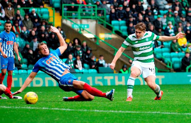James Forrest scores his sides third goal. Photo: PA