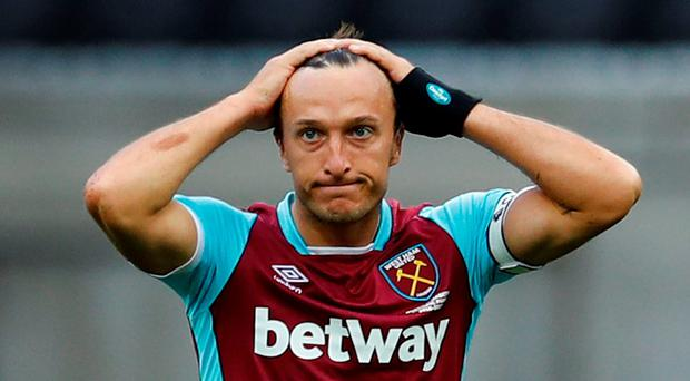 Mark Noble shows his dejection at West Ham's performance. Photo: Reuters
