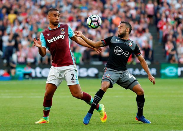 Southampton's Nathan Redmond in action with West Ham United's Winston Reid. Photo: Reuters