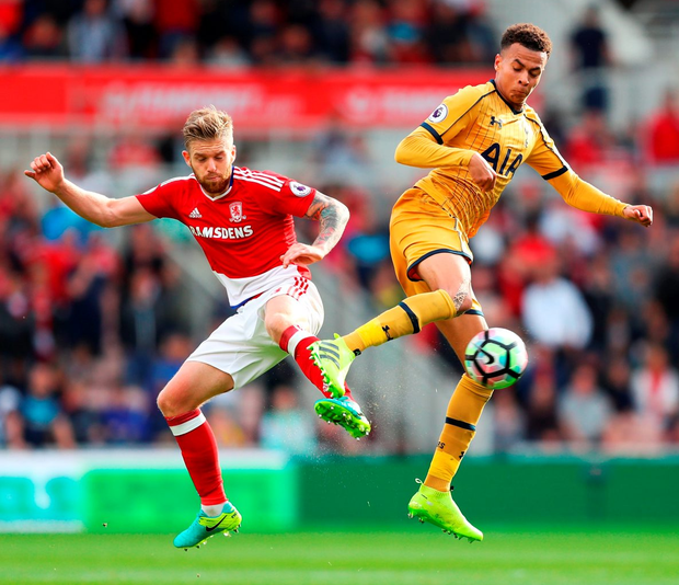 Middlesbrough's Adam Clayton of (L) and Spurs' Dele Alli battle for possession. Photo: Getty