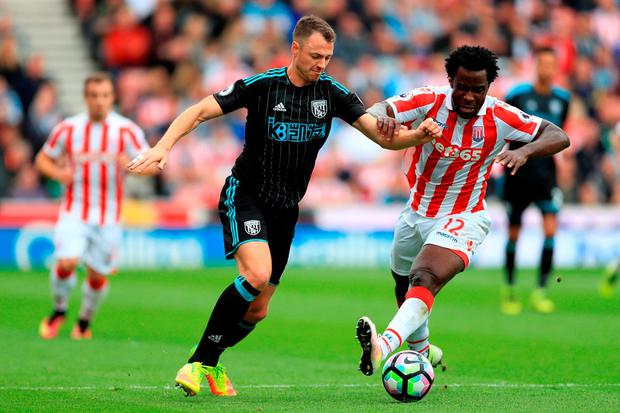 West Bromwich Albion's Jonny Evans (left) and Stoke City's Wifried Bony battle for the ball. Photo: PA