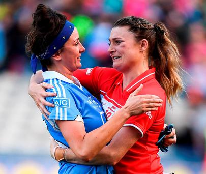 Cork's Annie Walsh consoles a devastated Niamh McEvoy of Dublin after a highly controversial end to the ladies' All-Ireland football final at Croke Park, in which the Rebel County won by a single point after Dublin had a critical point waved wide by the umpire. Photo: Brendan Moran