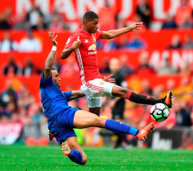 Danny Simpson (L) tackles Manchester United's Marcus Rashford (R). Photo: Getty