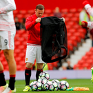 Wayne Rooney helps put out the footballs as the starting line-up warm up prior to Manchester United's victory against Leicester. Pic: Reuters