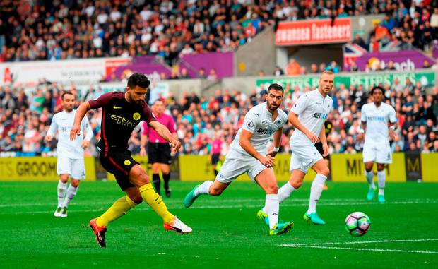 Sergio Aguero of Manchester City shoots to score his sides first goal. Photo: Getty