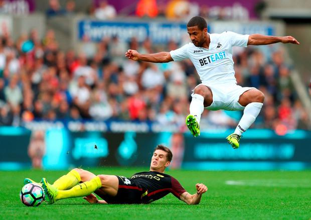 Wayne Routledge of Swansea City is fouled by John Stones of Manchester City. Photo: Getty