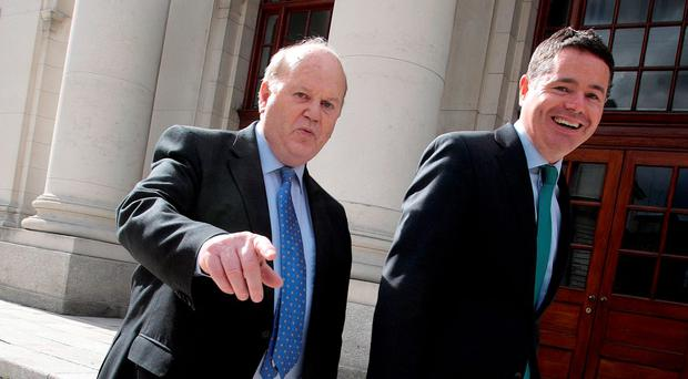 Finance Minister Michael Noonan and Minister for Public Expenditure Paschal Donohoe outside Government Buildings earlier this month. Photo: Tom Burke