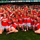 The Cork team celebrate winning the Brendan Martin Cup after beating Dublin. Photo by Brendan Moran/Sportsfile