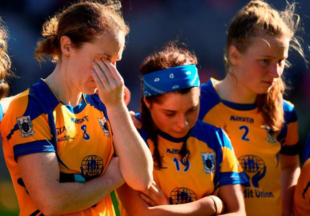 Dejected Clare players, from left, Louise Henchy, Caoimhe Harvey and Kayleigh McCormack after the final. Photo: Sportsfile