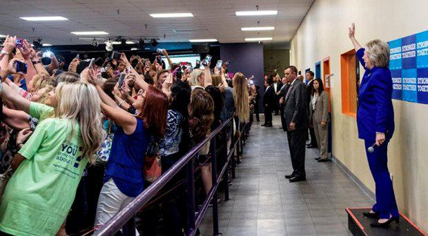 Hillary Clinton waves as the crowd takes selfies during a campaign stop in Orlando Credit: Twitter