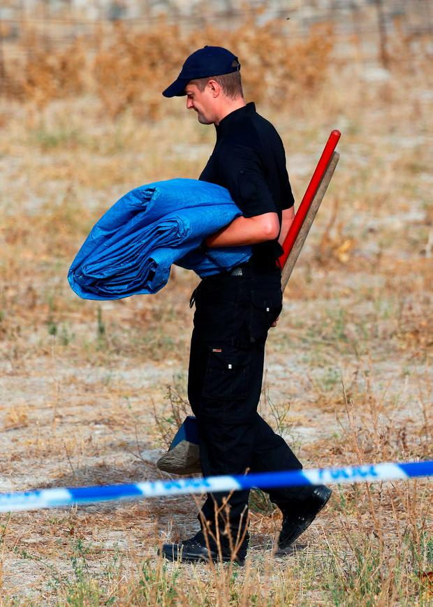Equipment is carried at the scene in Kos, Greece, as officers from South Yorkshire police start excavations in relation to the missing toddler Ben Needham.