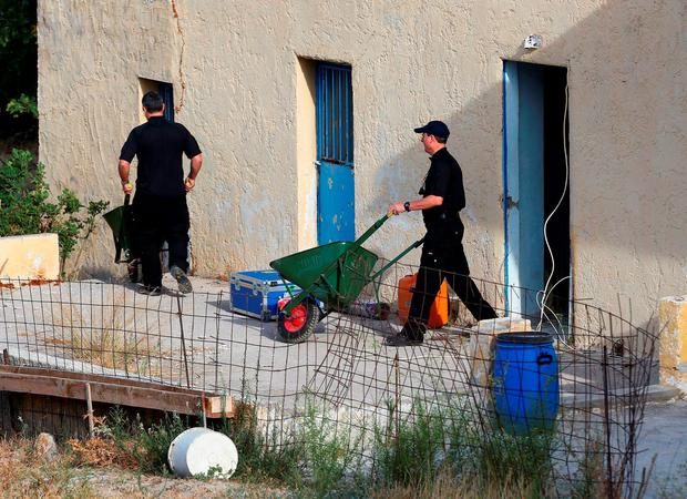 Equipment is carried at the scene in Kos, Greece, as officers from South Yorkshire police start excavations in relation to the missing toddler Ben Needham