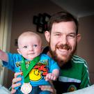Transplant Team Ireland Member James Reynolds pictured with his son Dylan at his Tallaght home yesterday. PIC COLIN O'RIORDAN