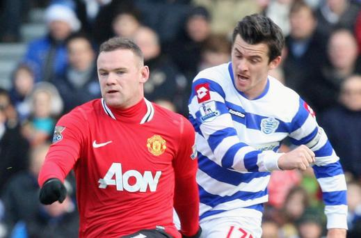 Barton in action against United while playing for Queens Park Rangers. Getty