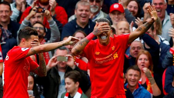 Liverpool's Philippe Coutinho and Roberto Firmino Reuters / Eddie Keogh