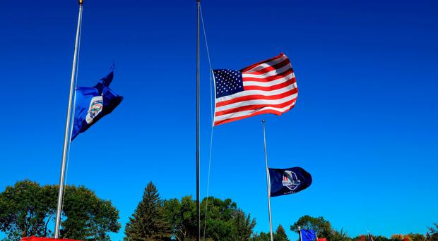 Flags fly at half-staff in honor of Arnold Palmer prior to the 2016 Ryder Cup at Hazeltine National Golf Club in Chaska, Minnesota. (Photo by David Cannon/Getty Images)