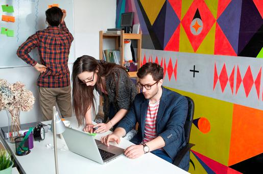 Casual chic: jeans and runners are becoming de rigueur in offices around the country. Photo posed by models