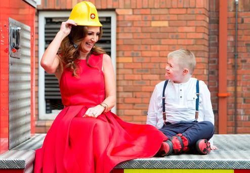 Broadcaster Lorraine Keane got some help from young Jake Lynch at the launch. Photo: Conor Healy Photography