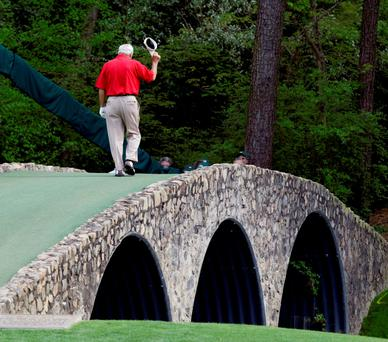 Arnold Palmer walking across the Hogan Bridge on the 12th fairway for the final time in Masters competition in 2004 (AP Photo/Amy Sancetta, File)