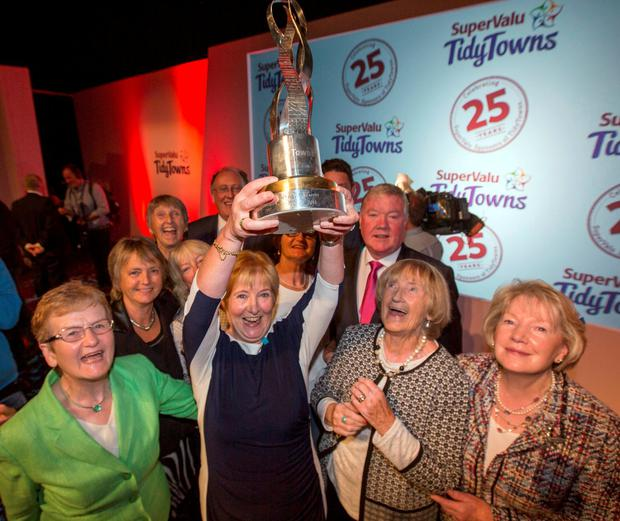 Maeve McGann, treasurer of the Skerries Tidy Towns committee holds the trophy alongside chairperson Anne Doyle. Photo: Mark Condren